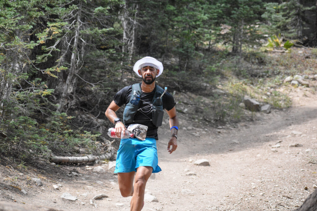 Runner coming into the aid station at castle peak